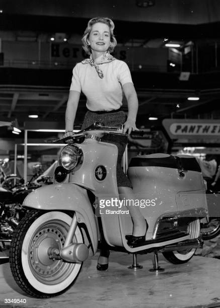 Film star Josephine Griffin posing on the new BSA Beeze Scooter at the Cycle and Motorcycle Show at Earls Court in London