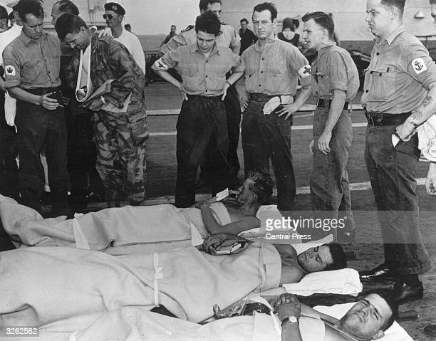 Injured French and British paratroopers aboard the HMS Eagle return to Malta after assault on Port Said in Suez.