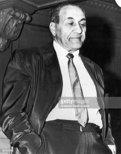 American mobster Anthony 'Tough Tony' Accardo stands with his hands in the pants pocket of his suit after being found guilty of income tax fraud