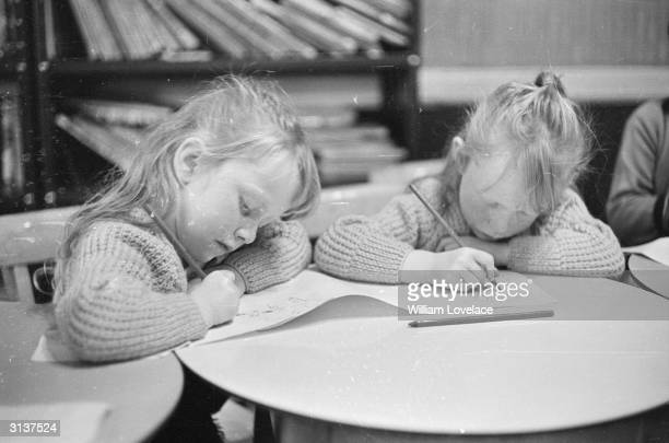 Two little girls from the Welsh village of Aberfan only a month after a coal tip collapsed on their school killing 144 people