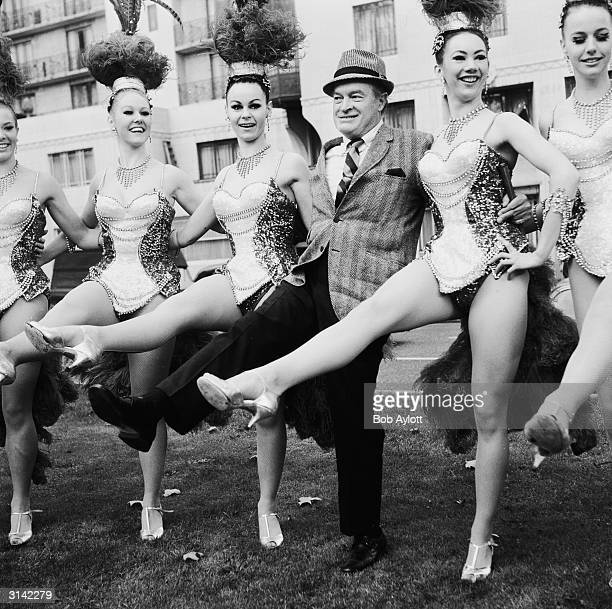 Comedian Bob Hope dancing with the Bluebell Girls at the Dorchester Hotel before appearing in his 20th Royal Command performance at the London...