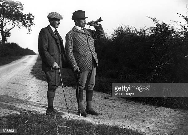 Arnold Allan Cecil Keppel and the Earl of Albemarle who is blowing his horn on the partridge shoot at Quidenham in Norfolk