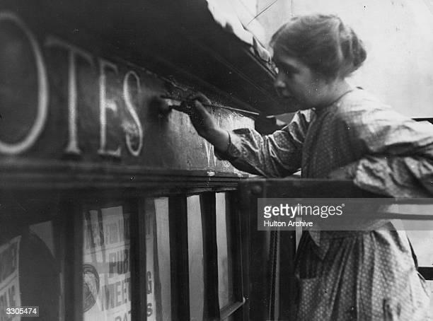 English suffragette Estelle Sylvia Pankhurst daughter of Emmeline and sister of Christabel Pankhurst at work on the facia of the Women's Social...