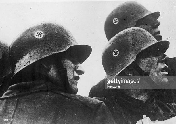 Released by the Nazi government 'To show the efficiency of our fire-fighting' the German caption to this picture reads; 'Two minutes after the alarm,...