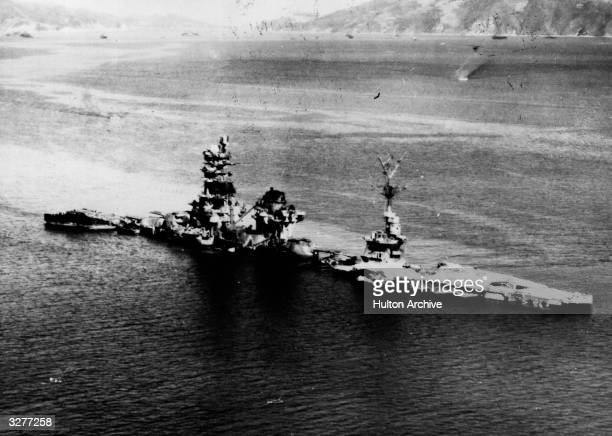 The Japanese Battleship Ise lies on the bottom of the Kube harbour after being blasted out of the water by the US airforce only the superstructure...