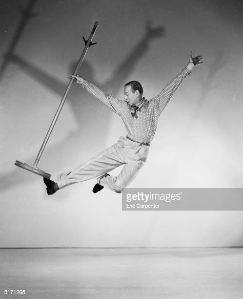 Hollywood star Fred Astaire performing a dramatic dance step with a hat stand for a partner in 'Royal Wedding' directed by Stanley Donen