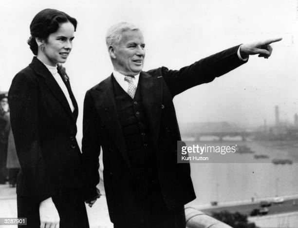 Actor and director Charlie Chaplin on the roof of the Savoy Hotel with his wife Oona Original Publication Picture Post 6099 Chaplin D P pub 1952