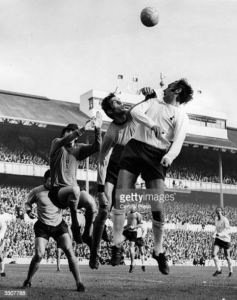 Alan Gilzean of Tottenham Hotspur leaps for the ball during a raid on the Wolverhampton Wanderers goal during their match at White Hart Lane...