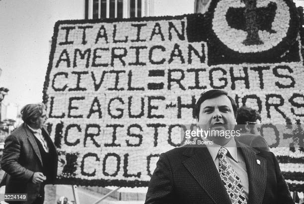 ItalianAmerican activist Anthony Colombo VicePresident of the ItalianAmerican Civil RIghts League with a floral tribute placed at the Columbus Statue...