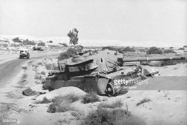 A tank destroyed in the Sinai desert during the Yom Kippur War