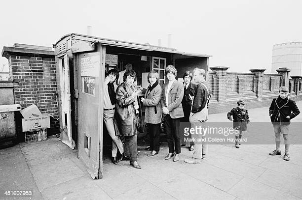 English rock and roll group The Rolling Stones posed at a pie stall on Chelsea Bridge in London on 11th October 1964 Left to right Keith Richards...
