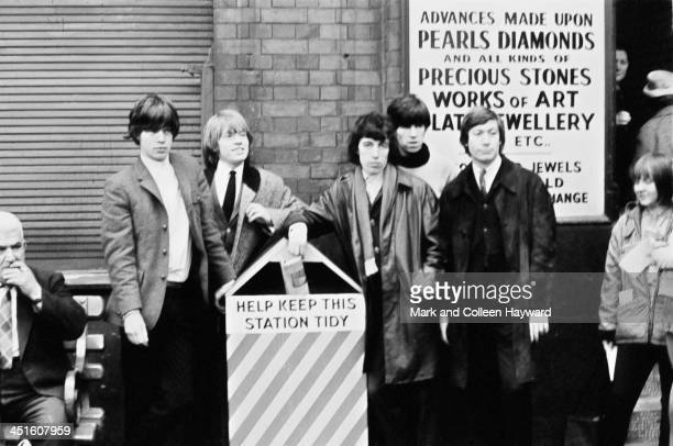 English rock and roll group The Rolling Stones posed at Victoria Station in London on 11th October 1964 Left to right Mick Jagger Brian Jones Bill...