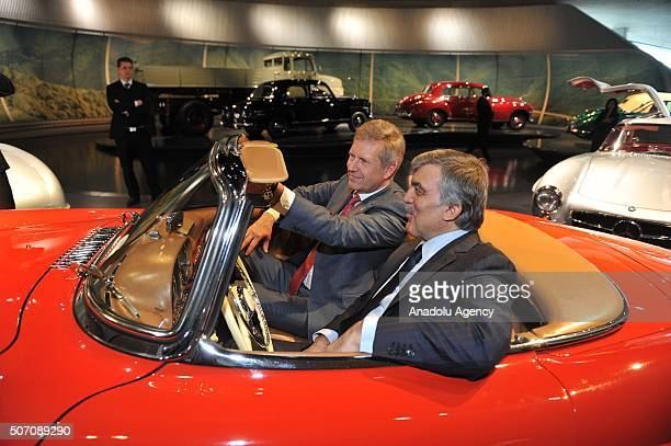 11th President of Turkey Abdullah Gul and Former President of Germany Christian Wulff are seen in a car at Mercedes-Benz Museum in Stuttgart, Germany...