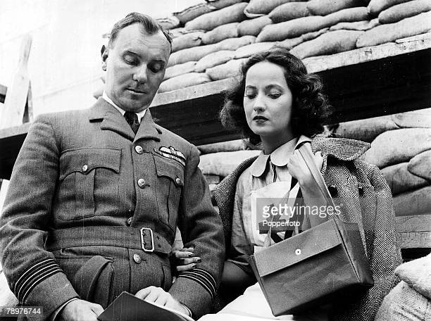 11th September 1939 Denham Studios England English actor Sir Ralph Richardson is pictured with actress Merle Oberon in their uniforms for scenes from...