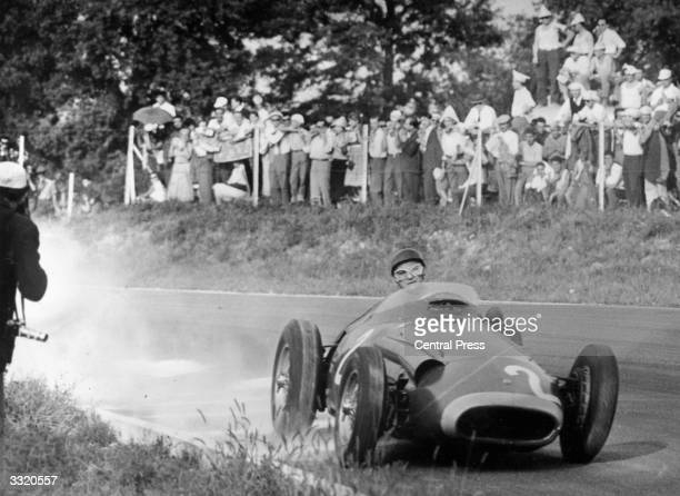 World champion Argentinian racing driver Juan Manuel Fangio in action driving a Maserati at the 1957 Italian Grand Prix at Monza He finished second...