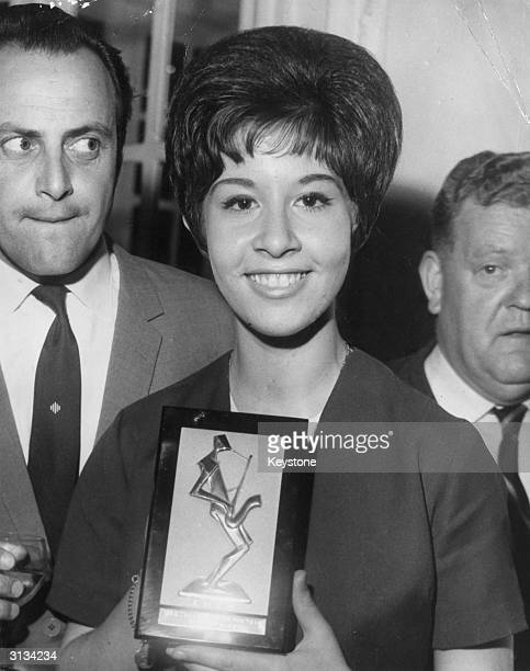 British pop singer Helen Shapiro voted Top Female Singer by the Variety Club of Great Britain with David Jacobs Top Disc Jockey of the Year