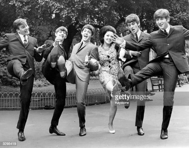 High kicking winners of the Melody Maker poll awards for 1963 from left Billy J Kramer who won the 'Best Hope For 1963' award The Beatles who won...