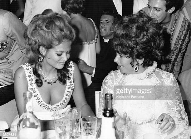 Film actress Elizabeth Taylor with Italian actress Claudia Cardinale at a charity ball in Venice during the Film Festival