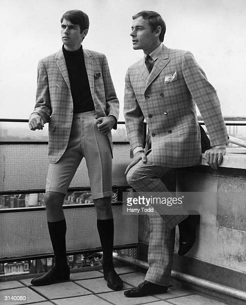 To r; Peter Wilson sports a grey and orange check, single-breasted jacket with Bermuda shorts and John Harding wears a grey and blue checked...