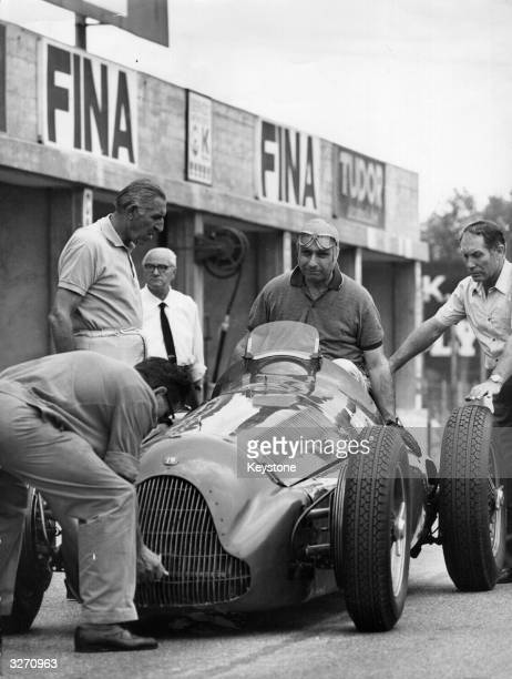Argentinian racing driver Juan Manuel Fangio in his Alfa Romeo racing car on the racing track at Monza Italy for the filming of his life story...