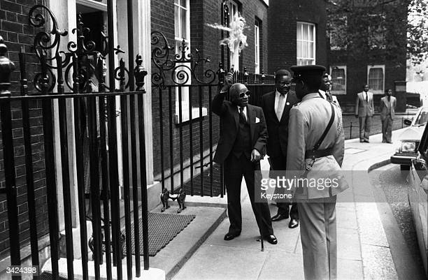 Dr Hastings Banda President of Malawi gives a wave to the crowd as he arrives at 10 Downing Street for talks with Prime Minister Margaret Thatcher