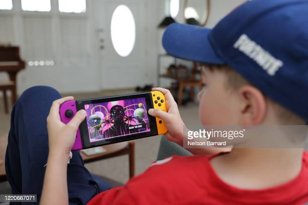 11yearold Ansel the photographer's son plays Fortnite featuring Travis Scott Presents Astronomical on April 23 2020 in South Pasadena California...