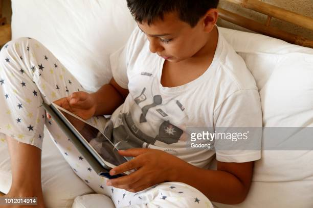 11yearold boy using a digital tablet in Salento Italy
