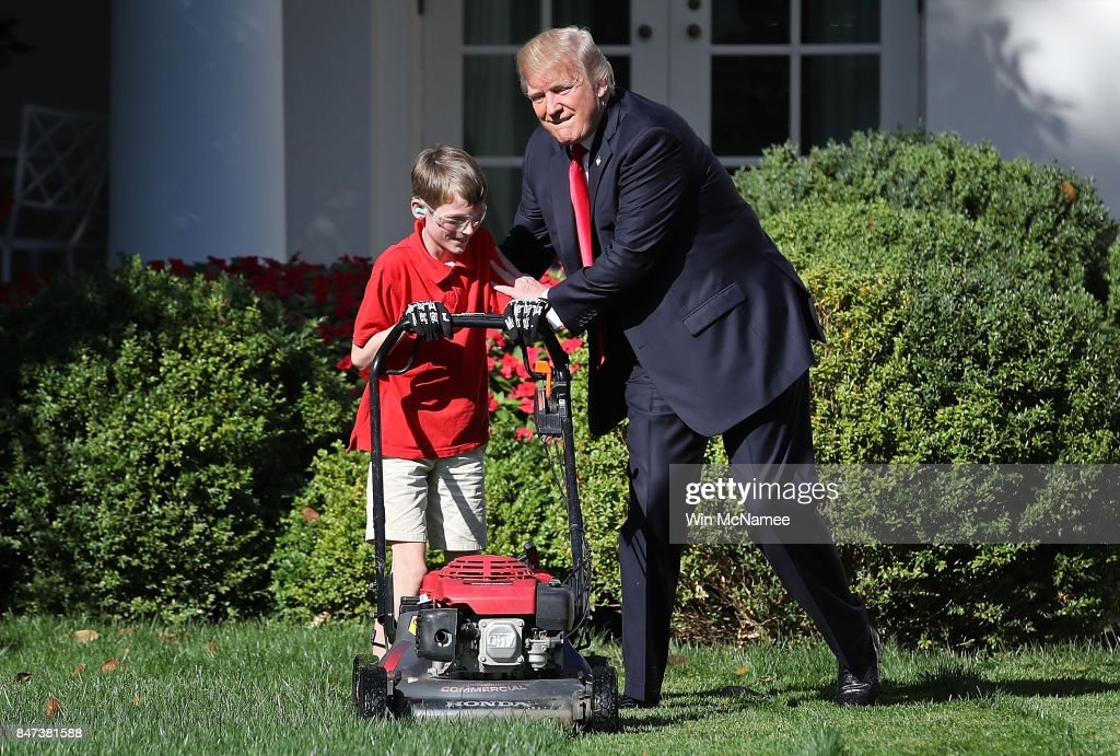 Hugging Frank 'FX' Giaccio, a young entrepreneur mowing the grass on the White House grounds, Washington, DC, September 15, 2017.