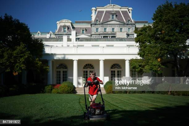 """Year-old Frank """"FX"""" Giaccio mows the grass in the Rose Garden of the White House September 15, 2017 in Washington, DC. Giaccio, from Falls Church,..."""