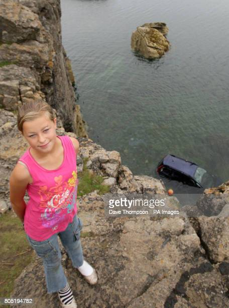 11yearold Paige Dean who cheated death after jumping from her grandfather's car before it fell 50ft off a cliff edge and landed in the sea in...