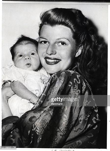 1/20/1945Hollywood CA Rebecca Welles born December 17th gets some moral support from her beauteous mama Rita Hayworth as she makes her first camera...