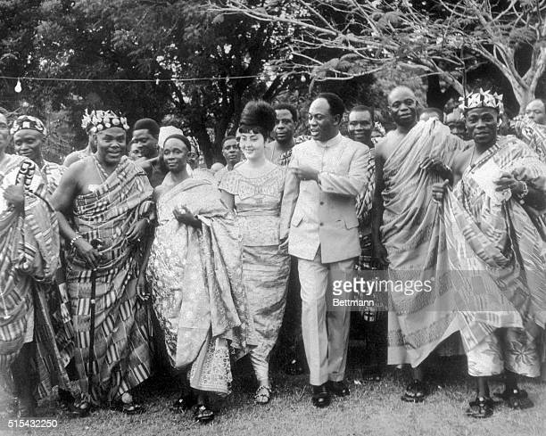 Accra, Ghana- Ghana President Kwame Nkrumah and his Egyptian-born wife, Madame Fathia Nkrumah , are flanked by paramount Chieftains as they dance to...