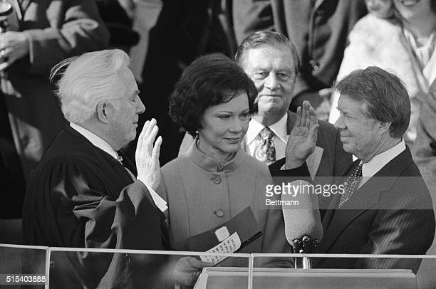 Washington, DC- Chief Justice Warren Burger administers the oath of office to Jimmy Carter as the United States' 39th President 1/20. Mrs. Carter...