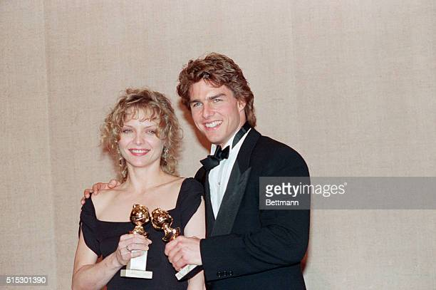1/20/1990Beverly Hills CAActress Michelle Pfeiffer and actor Tom Cruise pose with their Golden Globe awards Pfeiffer won Best Actrein a Drama for her...