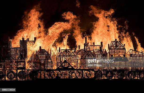A 120metre long wooden model of London's 17thcentury skyline burns on the River Thames after it was set alight in a dramatic retelling of the story...
