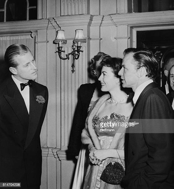 London, England: Crooner Frank Sinatra and his lovely bride, actress Ava Gardner, are greeted by the Duke of Edinburgh at the Empress Club Dinner in...