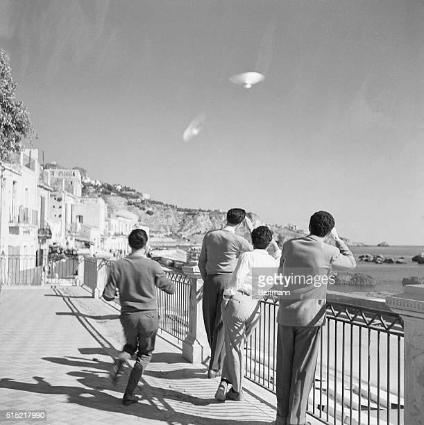 Sicily Italy Four Sicilians gaze skyward at two unidentified objects similar to those being mentioned in press reports and appearing in photos from...