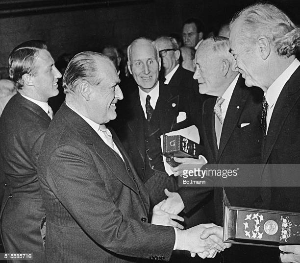 Oslo Norway Prince Harald and King Olav V of Norway congratulate winners of the 1962 and 1963 Nobel Peace Prizes at official presentation ceremonies...