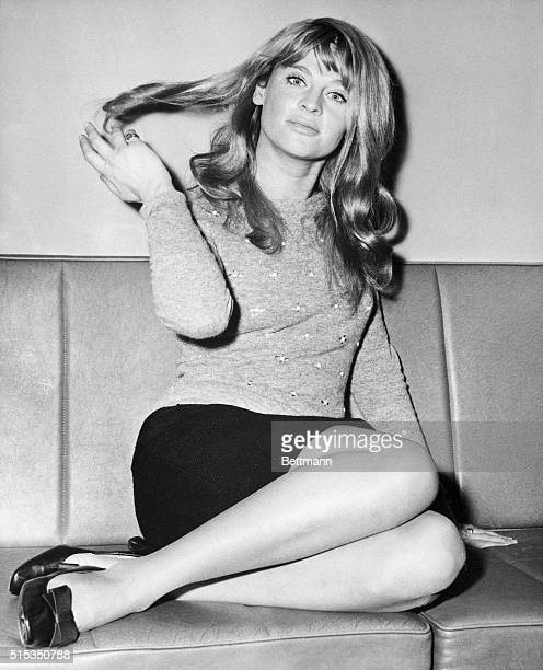 London EnglandActress Julie Christie strikes a pinup pose shortly before her departure for New York to attend the premiere of her latest fil 'Dr...