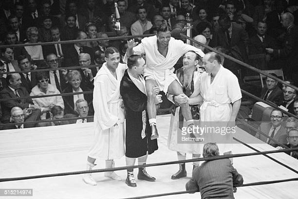 12/10/65New York NY Sugar Ray Robinson is elated as he is hoisted up by four boxers who gave him some of the toughest fights of his career during a...