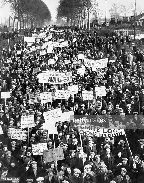 Paris, France- Some cheering enthusiastically and others grimly silent, hunger marchers from the French Province arrived at the gates of Paris, after...