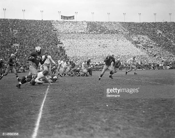 Los Angeles CA Robinson Gaining for UCLA in Tie With Trojans UCLA's fleet Negro halfback Jackie Robinson dashing around end for a gain as the Bruins...