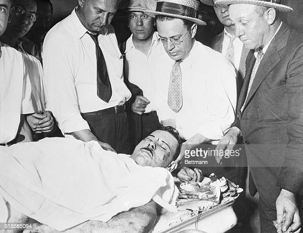 12/11/34Chicago Illinois The nation's public enemy No 1 on a slab in the county morgue in Chicago surrounded by policemen and coroner's assistants...