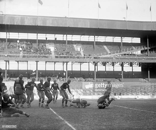 12/1/1929New York NYErnie Nevers Cardinal star squirms his way along the ground for a gain in the football match between the New York Giants and the...