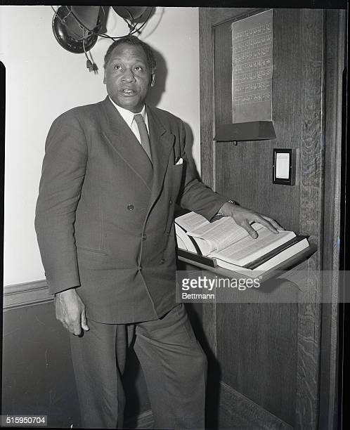 New York, NY: Paul Robeson , American actor and singer at communist trials, Federal Building.