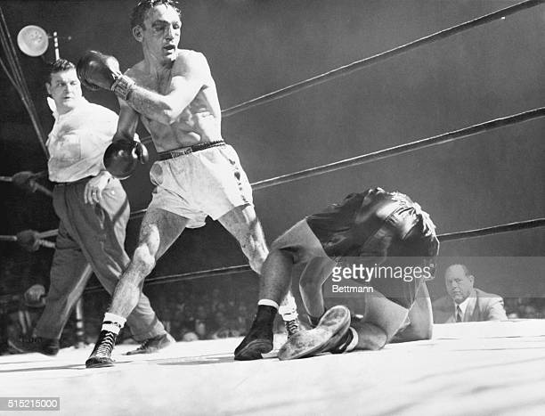 12/1/1955Boston MA Challenger Tony Demarco slumps to the canvas after taking a series of crashing lefts and rights from welterweight king Carmen...