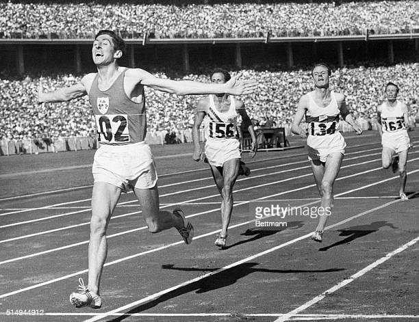 12/1/1956Melbourne Australia DELANEY WINS 1500 METERS With outstretched arms Ireland's Ron Delaney breasts the tape to win the final of the 1500...