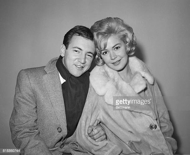 12/1/1960New York NY Singer Bobby Darin and actress Sandra Dee pose at Idlewild Airport after their secret marriage earlier in Elizabeth New Jersey...