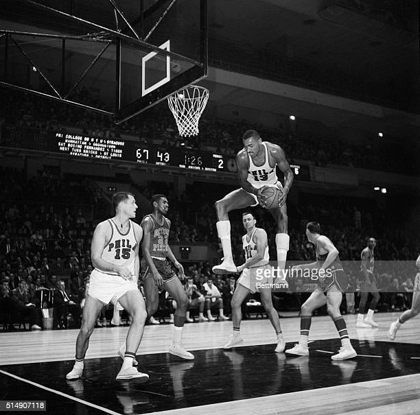 12/12/61New York NY High and mighty is Philadelphia's Wilt Chamberlain as he leaps up toward the Madison Square Garden ceiling to pick off a rebound...