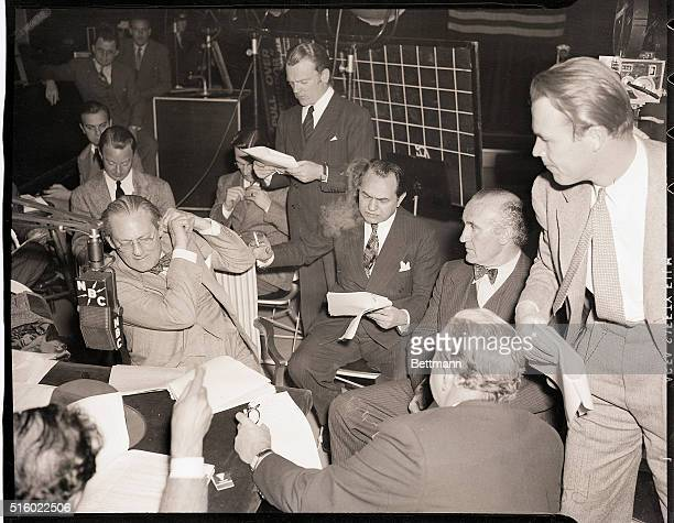 Hollywood, CA- Lionel Barrymore , James Cagney , Edward G. Robinson , Donald Crisp , Wayne Morris , and Walter Connolly concentrate on the broadcast...